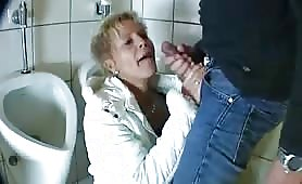 Guy fucks a mature lady in a public  bathroom